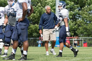 Head coach Paul Pasqualoni with his players during the team's open practice on Aug. 7. (Peter Morenus/UConn Photo)