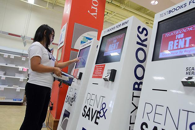 Xinyi Yi '15 (ENG) uses the textbook rental kiosk at the Co-op on Sept. 19, 2012. (Ariel Dowski/UConn Photo)