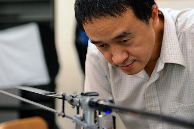 Professor Cao with autonomous vehicle.