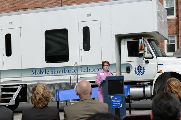 Regina Cusson, interim dean of nursing speaks at a ceremony to dedicate the Partnerships to Advance Nursing Practice's Mobile Simulation Laboratory outside Storrs Hall on Sept. 10, 2012. (Peter Morenus/UConn Photo)