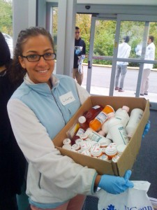 A nursing student carries containers of prescription drugs. (Photo provided by John Dobbins)