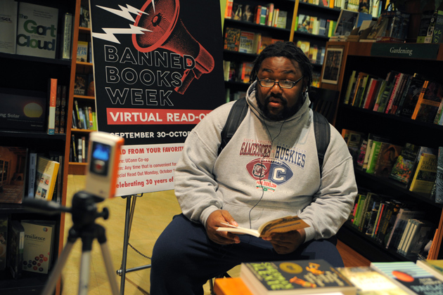 Taurean Stovall ('13 SFA) reads of Mice and Men on camera for Banned Books Week readings on Sept.5, 2012. (Max Sinton/UConn Photo)