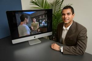 John Christensen, assistant professor of communication, with a health intervention video on Oct. 5, 2012. (Peter Morenus/UConn Photo)