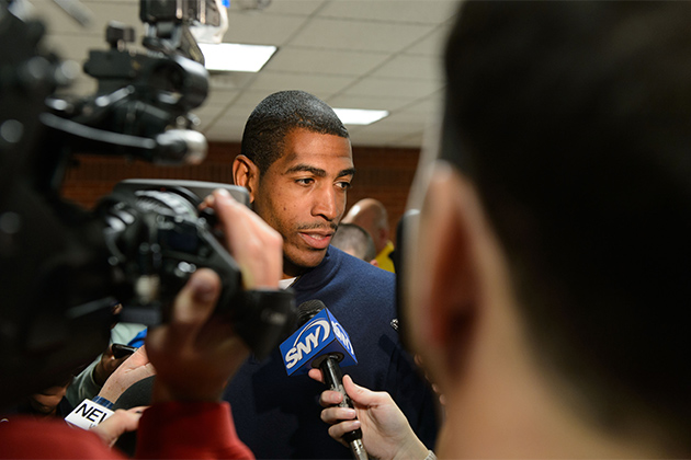 Men's Basketball Head Coach Kevin Ollie speaks with members of the media before the First Night show at Gampel Pavilion on Oct. 12, 2012. (Peter Morenus/UConn Photo)