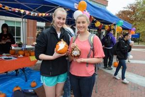 Stephanie Brady '16 (CLAS), left, and Maeve Maloney '16 (CLAS) show off their decorated pumpkins at Pumpkinfest on Fairfield Way on Oct. 26, 2012. (Ariel Dowski '14 (CLAS)/UConn Photo)