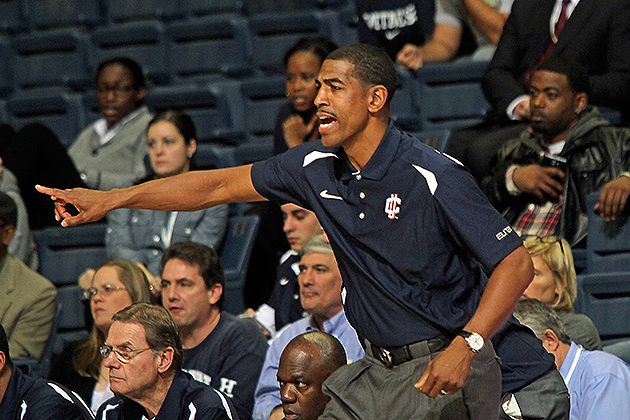 Men's head basketball coach Kevin Ollie '95 (CLAS) coaches from the sidelines. He is looking for total effort from his team in practice as well as in games. (Bob Stowell '70 (CLAS) for UConn)