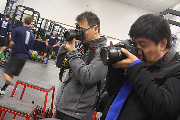 Members of the Chinese delegation captured all aspects of the baseball team's workout. The delegation was expected to make brief stops at several other universities during its time in the U.S., but its main focus was UConn. (Shawn Kornegay/UConn Photo)