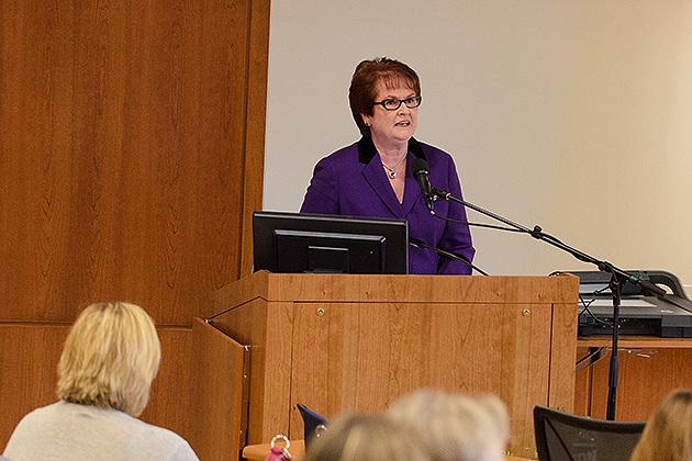 Regina Cusson, interim dean of the School of Nursing, speaks at the dedication ceremony. (Ariel Dowski '14 (CLAS)/UConn Photo)