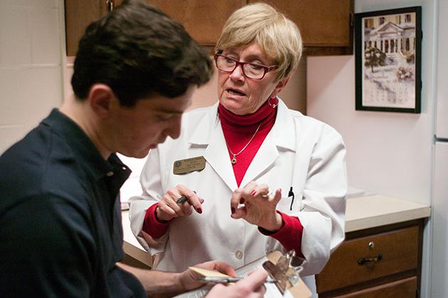 Kathleen Sanner, RN-BC, immunizes a patient at Student Health Services on Dec. 10, 2012. (Peter Morenus/UConn Photo)