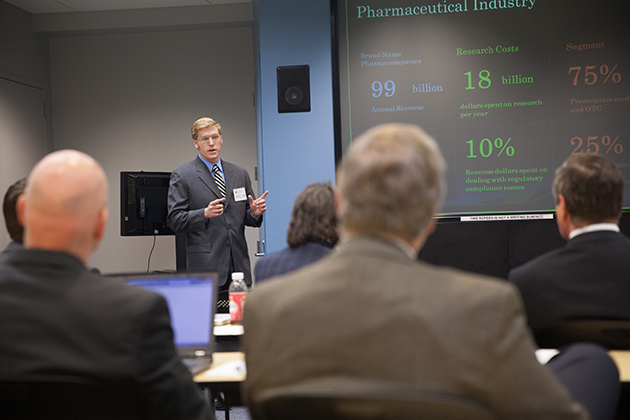 Robert Johnson '13 (BUS) explains a proposal to IBM executives on how its Watson supercomputer could be used in the pharmaceutical industry. Johnson and six other students in the School of Business developed their proposals in a collaboration with IBM Watson through a class at UConn's Stamford Learning Accelerator. (Zach Wussow for UConn)