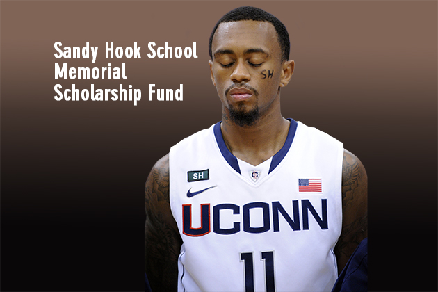 Connecticut's Ryan Boatright participates in a moment of silence honoring those killed in a school shooting in Newtown, Conn., last Friday. The service was held before an NCAA college basketball game between Connecticut and Maryland Eastern Shore in Hartford, Conn., Monday, Dec. 17, 2012. (AP Photo/Fred Beckham)