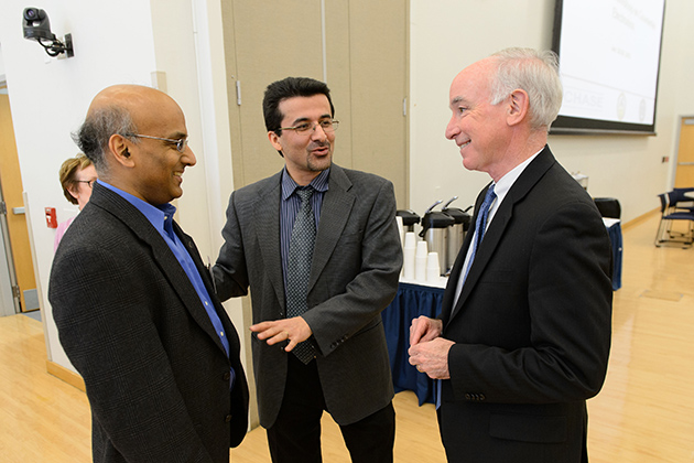 U.S. Rep. Joe Courtney, right, speaks with John Chandy, left, associate professor of electrical and computer engineering, and Mohammad Tehranipoor, director of the Center for Hardware Assurance, Security, and Engineering, during a counterfeit electronics conference at the Student Union Ballroom on Jan. 28. (Peter Morenus/UConn Photo)