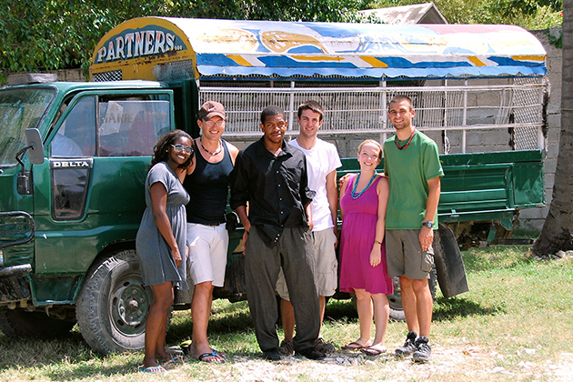 Professor Thomas Craemer, second from left, traveled to Haiti last year with UConn students (from left) Marissa Mack, Omar Green, Parker Sorenson, Caty Wagner, and Patrick Turek, shown here in front of a 'tap-tap' (pick-up truck) owned by Partners in Development. (Photo courtesy of Patrick Turek)
