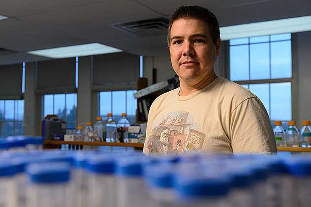 Andrew Pask, associate professor of Molecular & Cell Biology working in his lab. (Peter Morenus/UConn Photo)