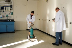 David Bourret and Robert Lawson of Research Safety check an emptied laboratory for radiation before construction begins. (Tina Encarnacion/UConn Health Center Photo)