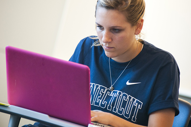 A student works on her computer in the new classroom building. (Al Ferreira for UConn)