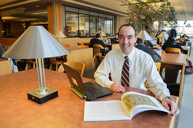 Brendan Kane, associate professor of history and associate director of the Humanities Institute, in the reading room of the Homer Babbidge Library. (Ariel Dowski '14 (CLAS)/UConn Photo)