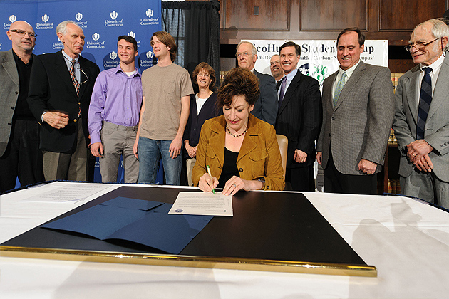 President Susan Herbst signs UConn's Climate Action Plan on March 26, 2012. (Peter Morenus/UConn Photo)