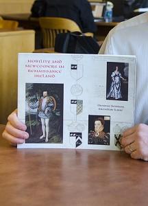 Brendan Kane displays the catalog for the exhibition. (Ariel Dowski '14 (CLAS)/UConn Photo)
