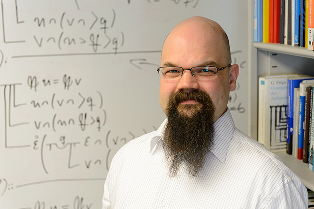 Marcus Rossberg, assistant professor of philosophy, is co-editor of a new translation of Frege's Basic Laws of Arithmetic, to be published this summer by Oxford University Press. (Peter Morenus/UConn Photo)