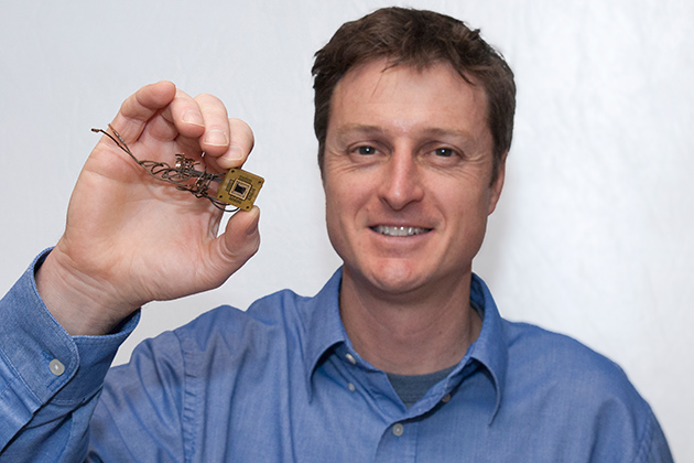 Brian Willis holds a rectenna device. (Sean Flynn/UConn Photo)
