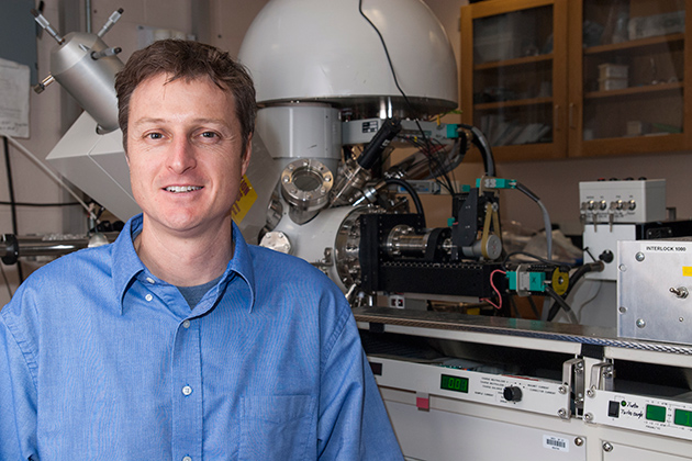 Brian Willis, associate professor of chemical, materials, and biomolecular engineering, in his lab, with an X-ray photoelectron spectrometer. (Sean Flynn/UConn Photo)