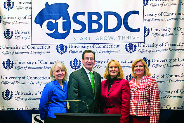 From left, DECD Commissioner Catherine Smith, Gov. Dannel P. Malloy, Mary Holz-Clause, UConn's Vice President for Economic Development, and Jeanne Hulit, SBA Associate Administrator for Capital Access, during a press conference launching the Connecticut Small Business Development Center initiative. (Shana Sureck for UConn)
