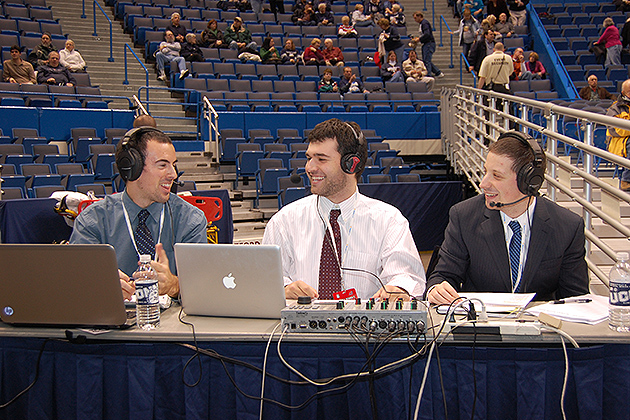 The WHUS crew, (l to r) Josh Baron'13 (CLAS), John Ponziani '13 (CLAS), and Spencer Warshaue '14 (ENG) prepare to broadcast a basketball game at the XL Center in Hartford. (Ken Best/UConn Photo)