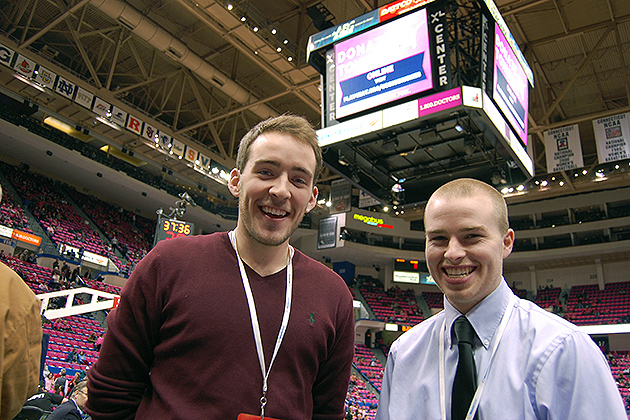 WHUS sports directors Andrew Callahan '13 (CLAS), left, and Chris Jones '13 (CLAS) at the XL Center in Hartford before broadcasting a women's basketball game. (Ken Best/UConn Photo)