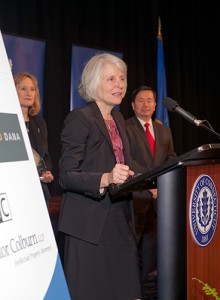 DECD Commissioner Catherine Smith accepts her Innovations Champion award as UConn's Vice President of Economic Development Mary Holz-Clause and Provost and Executive Vice President Mun Choi look on. (Tom Hurlbut for UConn)