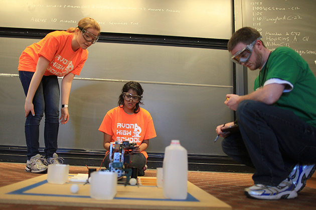 Mary Kaminski (left) and Aneesha Ramen of Avon High School use the robot arm they built from scratch to perform tasks in a timed trial at the annual Connecticut Science Olympiad held at UConn this weekend. (Michael Fiedler for UConn)