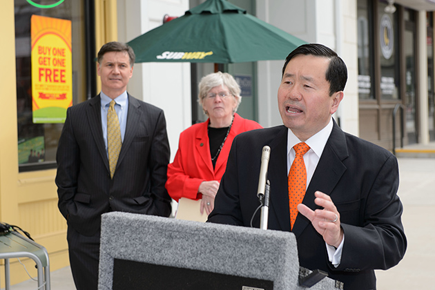 Provost Mun Choi speaks at Storrs Center, as Dan Esty, DEEP commissioner, and Mansfield Mayor Betsy Paterson look on. (Peter Morenus/UConn Photo)