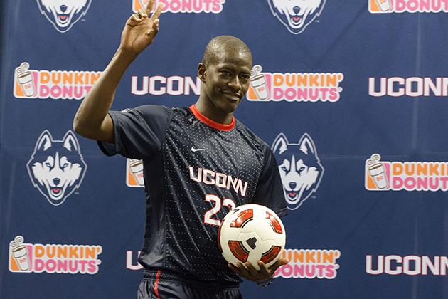 Mamadou Doudou Diouf '14 (CLAS) models a new soccer uniform during a ceremony held at Gampel Pavilion on April 18, 2013. (Peter Morenus/UConn Photo)