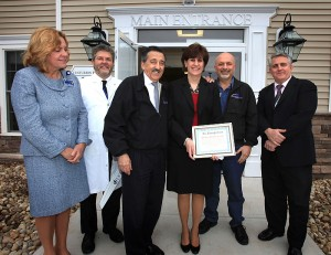 During the Open House, the Health Center was awarded a 2013 Beautification Award from the Southington Chamber of Commerce.  (left to right) Amanda Hopkins-Tirrell, Denis Lafreniere, Art Secundo from the Southington Chamber of Commerce, Anne Horbatuck, Charlie Cocuzza from the Southington Chamber of Commerce and Gus Mazzocca on April 11, 2013. (Michael Fiedler/UConn Health Center Photo)