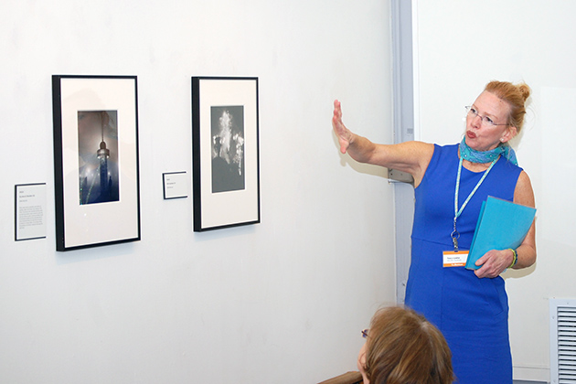 "Tracy Lawlor, education coordinator at The William Benton Museum of Art, discusses ""The Secret Paris of the 1930's: Vintage Photographs by Brassai"" exhibition with attendees of the Connecticut Art Docent Network Symposium. (Ken Best/UConn Photo)"