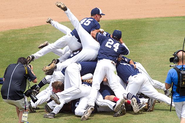 The baseball team pile up.