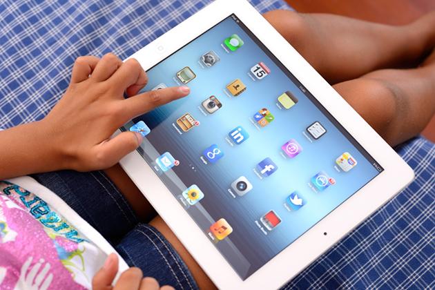 Student using an iPad.
