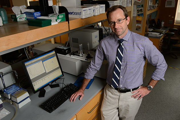 Nathan Alder, assistant professor of molecular and cell biology at his lab on June 27, 2013. (Peter Morenus/UConn Photo)