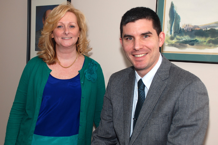 Wendy Martionson, R.N., MSN, with Dr. Jason Ryan (right), who nominated her for a 2013 Connecticut Health Association Healthcare Hero award. (Janine Gelineau/UConn Health Center Photo)
