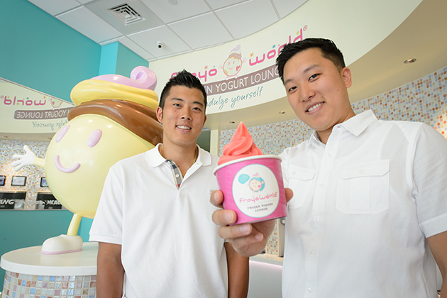 Brothers Willam Bok '08 (CLAS), left, and William Bok '04 (BUS), owners of Froyo World at Storrs Center on July 23, 2013. (Peter Morenus/UConn Photo)