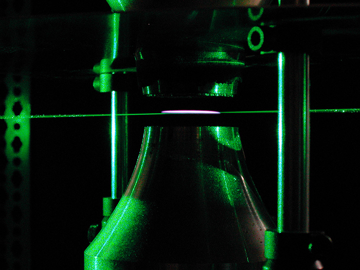 A pulsed laser is used to measure the temperature at the point where a laminar flame is extinguished. (Image courtesy of Michael Renfro)