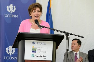 President Susan Herbst speaks at an event held at the University of Connecticut Depot Campus to mark the Inauguration of the Fraunhofer Center for Energy Innovation (CEI) at UConn on July 25, 2013. Seated at right is Provost Mun Choi. (Peter Morenus/UConn Photo)