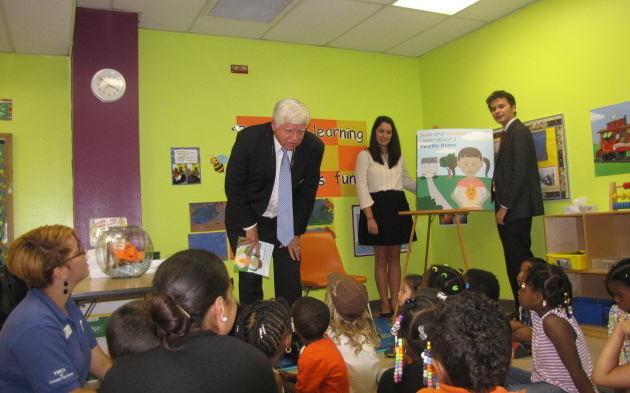 Youngsters enrolled in a YMCA child care program at the Lois Nolan Larson Community Center were introduced to Susie and Jerome by Congressman John B. Larson (CT01) in a special event planned by the UConn Department of Extension. Jerome can be seen 'swimming' in his fish bowl directly under the clock, at left. (Sheila Foran/UConn Photo)