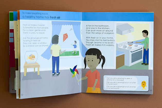 Photos of a illustrated brochure named Susie and Jerome learn about a healthy home on Aug. 2, 2013. (Sean Flynn/UConn Photo)