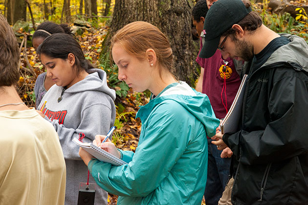 Hannah Gousse '14 takes field notes during an ecology class taught by Jenica Allen, assistant professor-in-residence. (Sean Flynn/UConn Photo)