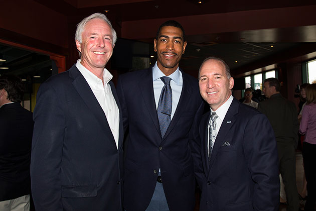 Bridgeport mayor Bill Finch '79 (CANR), left, men's basketball head coach Kevin Ollie '95 (CLAS), and Howard Saffan, president of Harbor Yard Sports and Entertainment, after a press event on Oct. 7, 2013 announcing that the men's and women's basketball teams will each play a games in Bridgeport during the 2013-2014 season. (Stephen Slade '89 (SFA) for UConn)