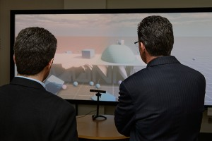 Horea Ilies, left, associate professor of mechanical engineering, shows a virtual reality demonstration to Gov. Malloy after a ceremony on campus in October to celebrate the Next Generation Connecticut initiative. (Peter Morenus/UConn Photo)