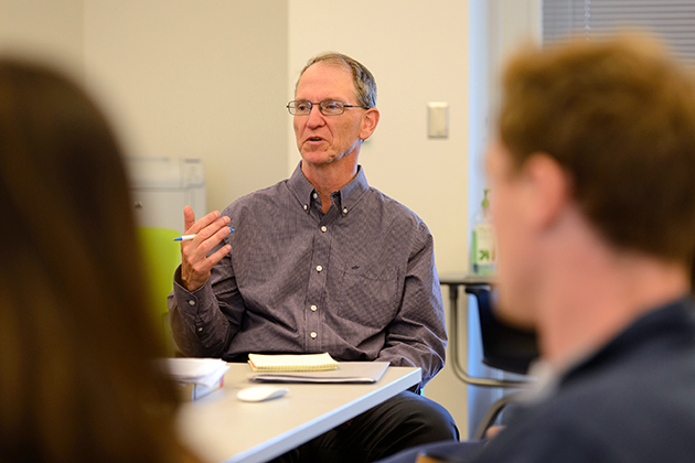 Michael Stanton, associate professor of journalism, leads a class at Oak Hall on Sept. 25, 2013. (Peter Morenus/UConn Photo)