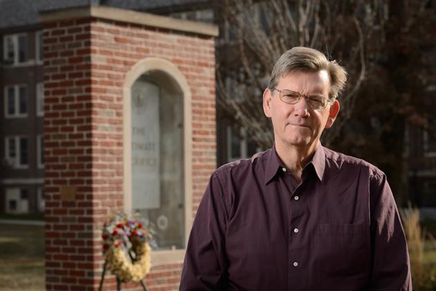 Ken Foote, head of geography, at the Ultimate Sacrifice Memorial on Nov. 15, 2013. (Peter Morenus/UConn Photo)