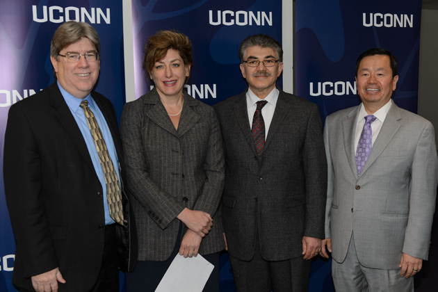 J. Michael McQuade, UTC senior vice president of science and technology, left, President Susan Herbst, Kazem Kazerounian, interim dean of engineering, and Provost Mun Choi announced the launch of the UTC Institute for Advanced Systems Engineering at UConn. (Peter Morenus/UConn Photo)